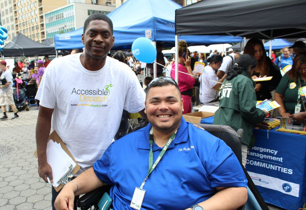 Photo of Accessible Dispatch Outreach Coordinator and Community Emergency Response Team Liaison in a wheelchair at the 2018 Disability Pride Parade.