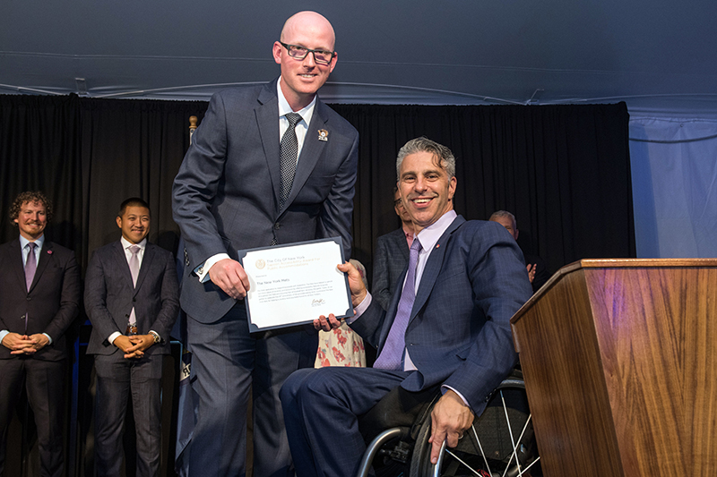 Image of Public Accommodations Award Accepted by Eric Petersen, Accessibility Coordinator and Director of Ticket Services for New York Mets