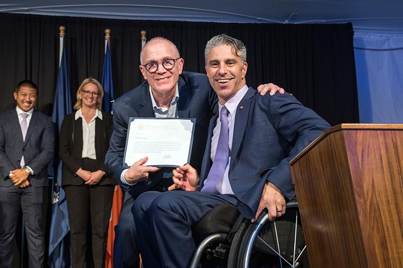 Image of Frieda Zames Advocacy Award winner Rick Surpin hugging Commissioner Victor Calise