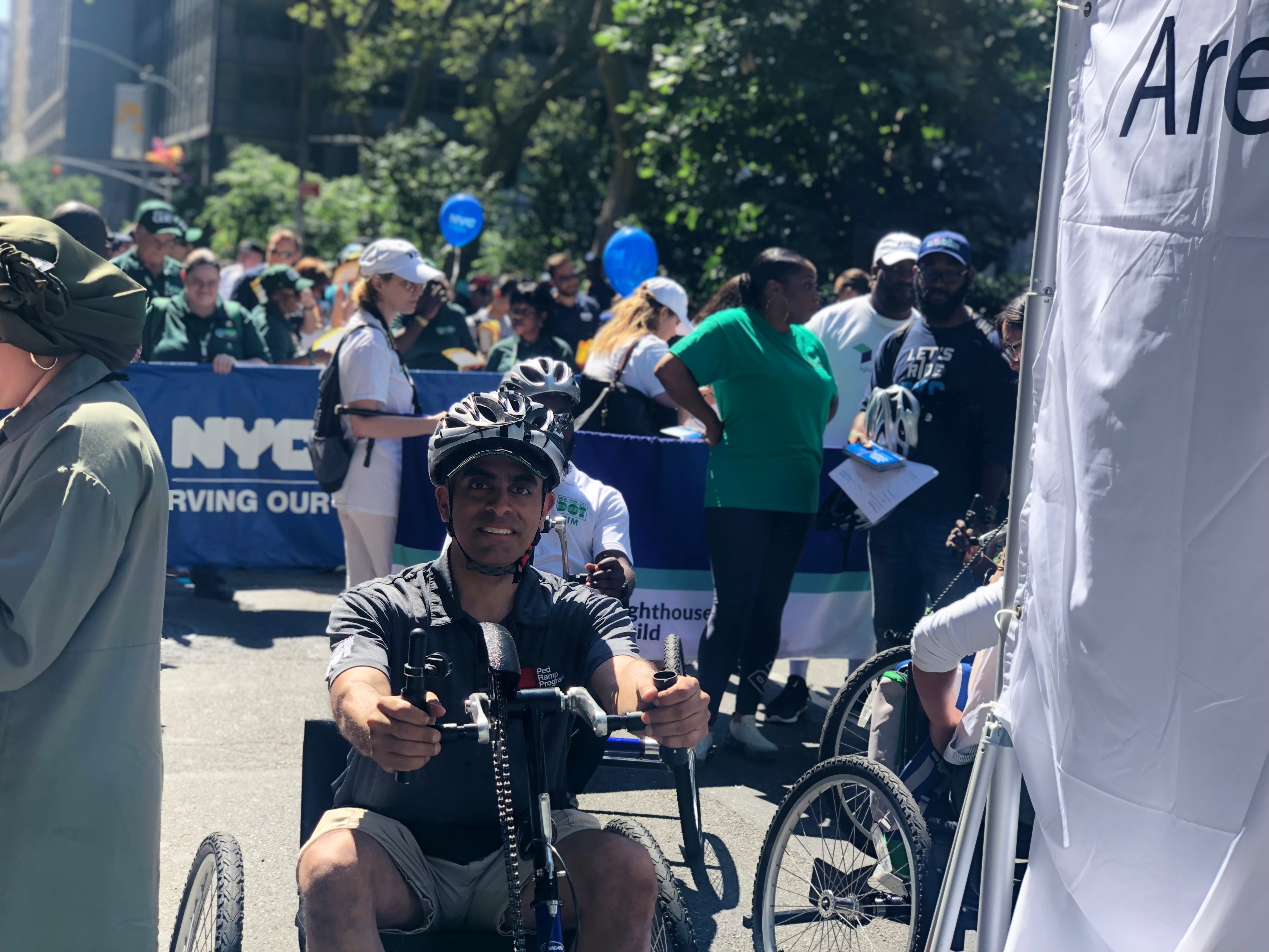 A young athlete in hand bike at fifth annual disability pride parade, New York.