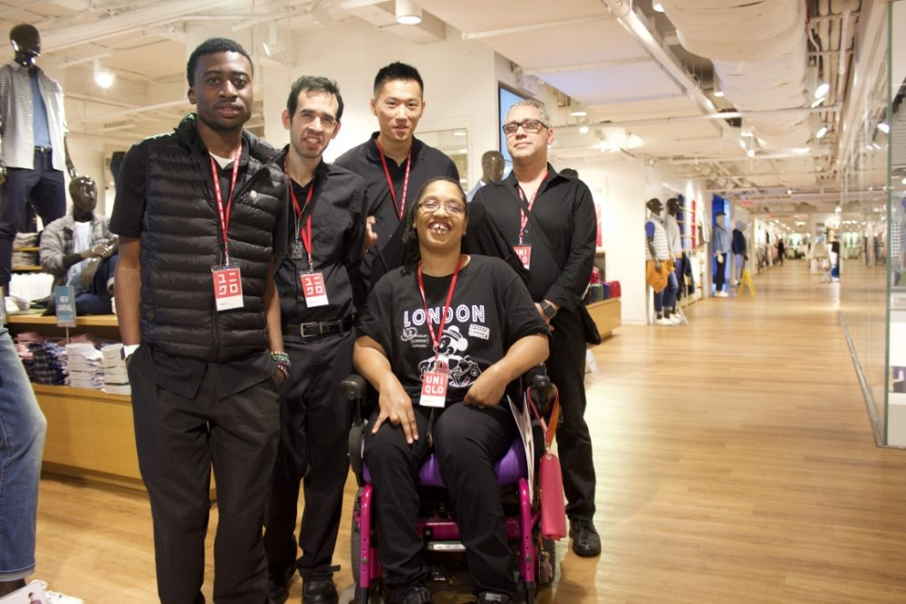 Glenn Jones, Glenn Roback, Shan Lin, Kanema Varner, and Antonio Suazo posing at a UNIQLO store in Manhattan where they all work