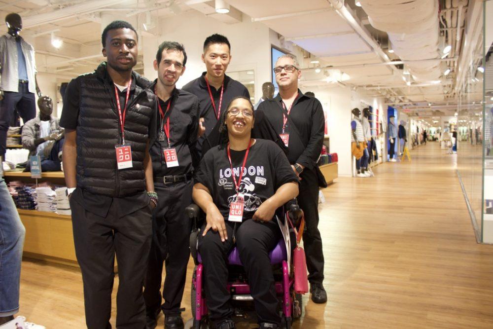 Glenn Jones, Glenn Roback, Shan Lin, Kanema Varner, and Antonio Suazo posing at a UNIQLO store in Manhattan where they all work