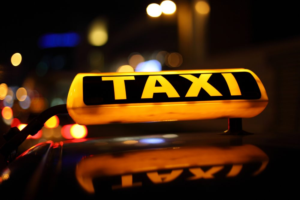 Yellow taxi sign illuminated at night