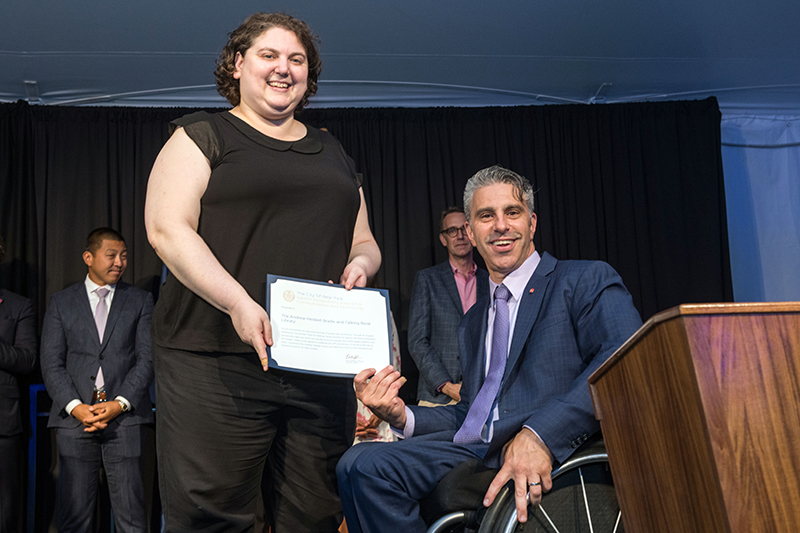Image of Jill Rothstein, Chief Librarian accepting Communications and Technology Award on behalf of Andrew Heiskell Braille and Talking Book Library