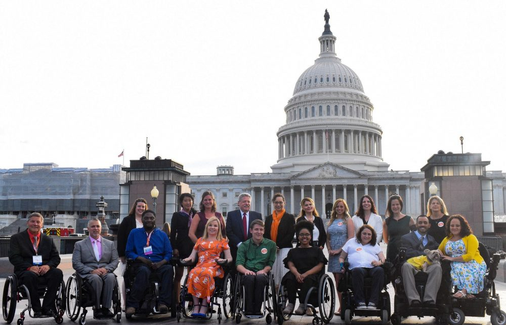 Images of united spinal representatives during Roll on Capitol Hill banner.